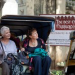 Actors Judi Dench and Celia Imrie make an entrance in a tuk tuk