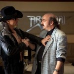 Actors Tom Cruise and Paul Giamatti in the movie Rock of Ages