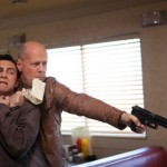 Actors Joseph Gordon-Levitt and Bruce Willis in Looper