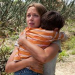 Emily Blunt and the weird kid in Looper