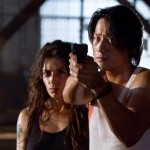 Sarah Shahi as Sly's daughter and Sung Kang in Bullet to the Head