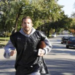 Bradley Cooper runs, and yes, that is a garbage bag he's wearing! in Silver Linings Playbook