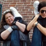 Melissa McCarthy and Sandra Bullock pulling a leg in The Heat