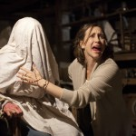 Very Farmiga helping to perform a makeshift 'exorcism' in The Conjuring