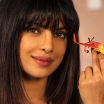 Priyanka Chopra poses with her character toy Ishani