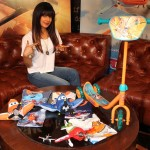 Actor Priyanka Chopra (voice of Ishani) poses with merchandise from the PLANES film