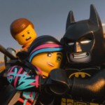Wyldstyle and Batman snuggle up as Emmet looks on in The LEGO Movie