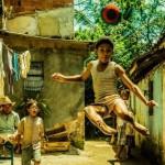 Leondardo Lima Carvalho as the young Dico (Pele) in Pele: Birth of a Legend