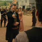 Peter Sarsgaard about to shoot Matt Bomer in The Magnificent Seven
