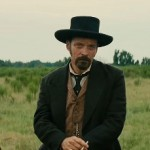 Peter Sarsgaard (centre) in The Magnificent Seven
